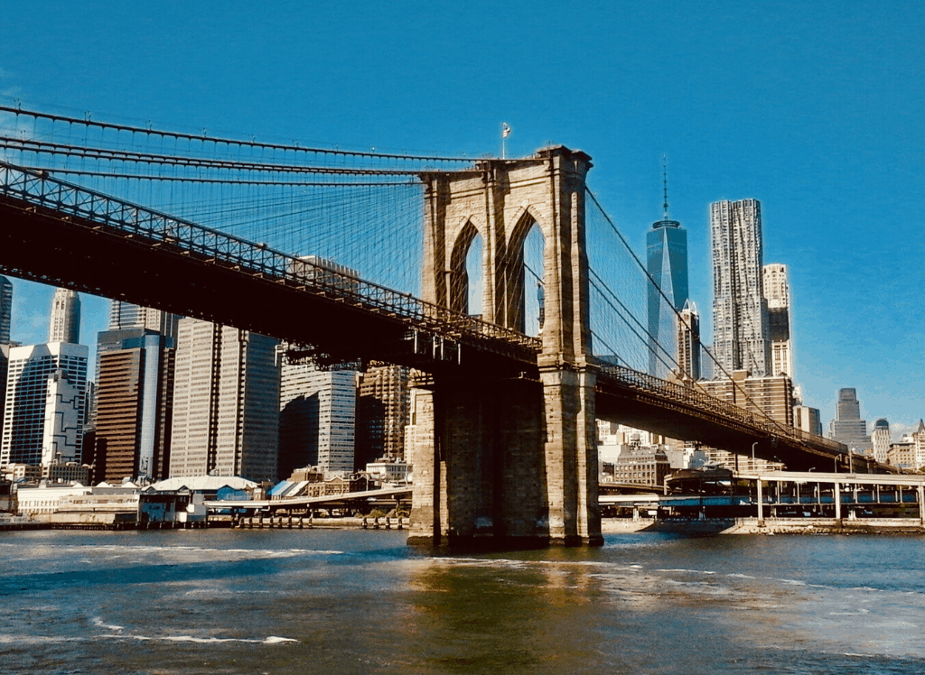 The Brooklyn Bridge and New York City's iconic skyline.