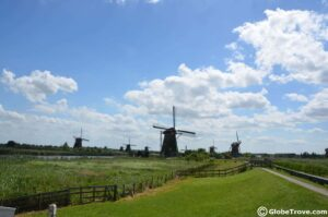 Kinderdijk is a quaint little spot in the Dutch countryside that is dotted with historic windmills that help farmers drain their fields of excess water.