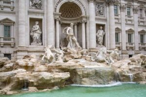Tossing a coin in the Trevi Fountain is one of the great free things to do in Rome, Italy.