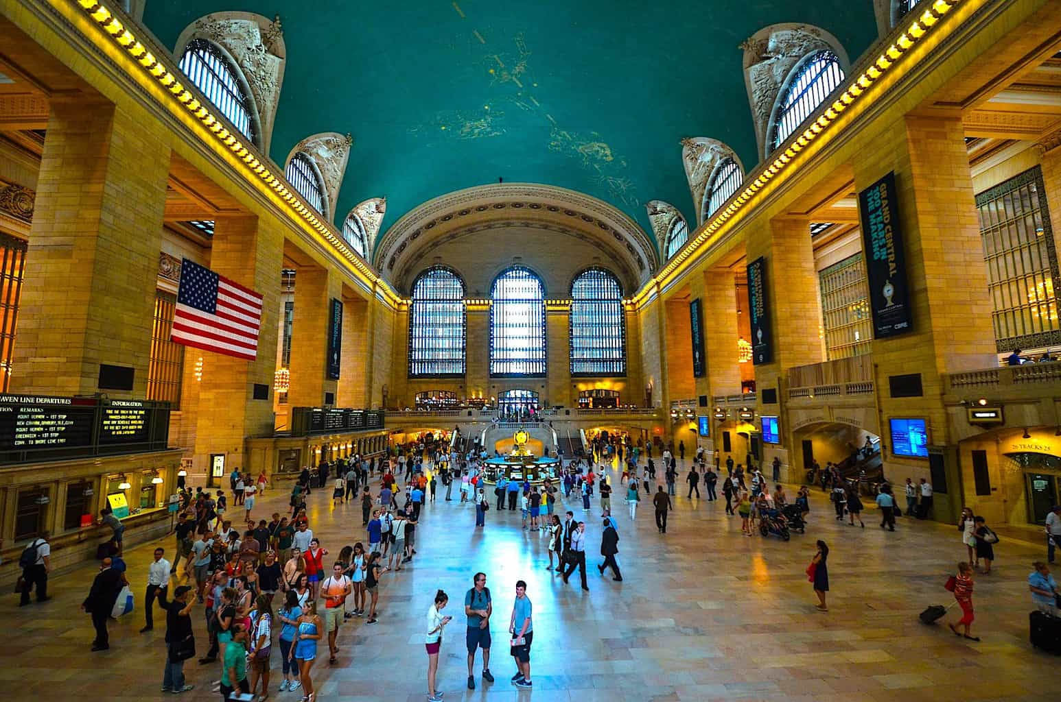 The expansive interior of Grand Central terminal with its central clock and constellation embued ceiling.