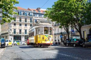 The iconic, yellow, tram 28 that runs through Lisbon, Portugal.