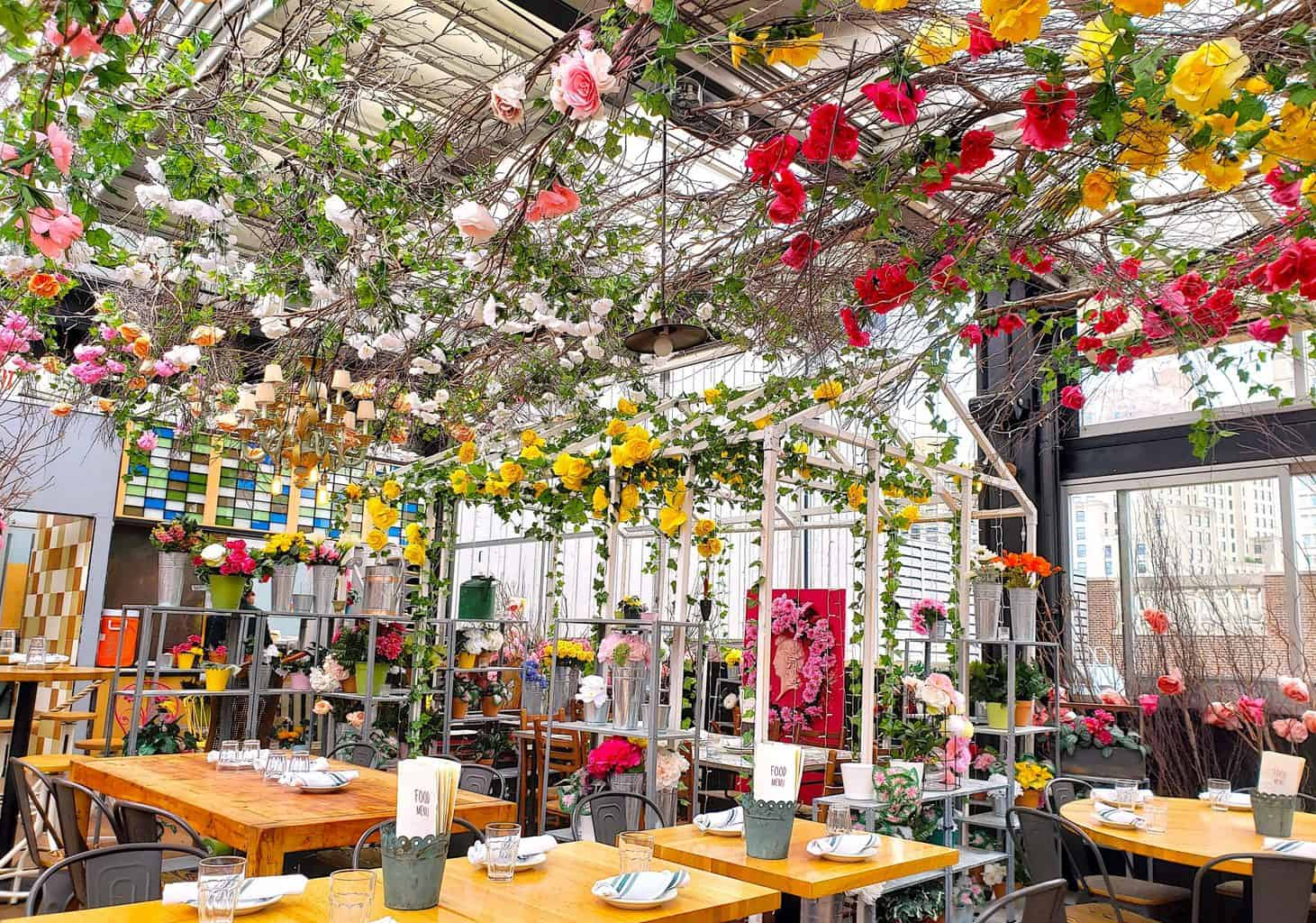 Serra by Birreria rooftop bar with beautiful floral decor.