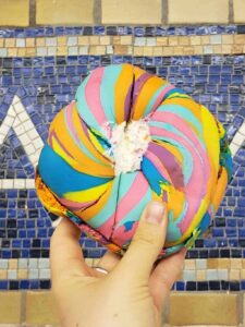 One of the most unusual things to do in NYC is to stop by the Bagel Store in Brooklyn and pick up a rainbow bagel with cake better cream cheese!