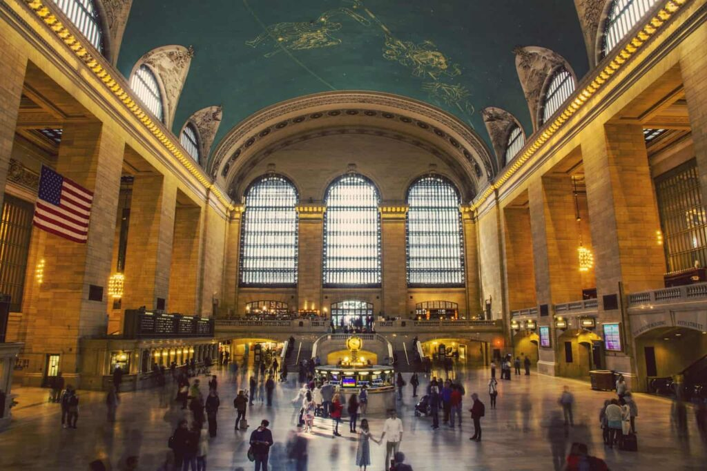 The beautiful interior architecture and constellation studded, turquoise ceiling of Grand Central Terminal in NYC.