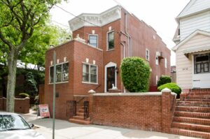 The unassuming, brick exterior of the Louis Armstrong House in Carona, Queens (image sourced from Flickr.com).