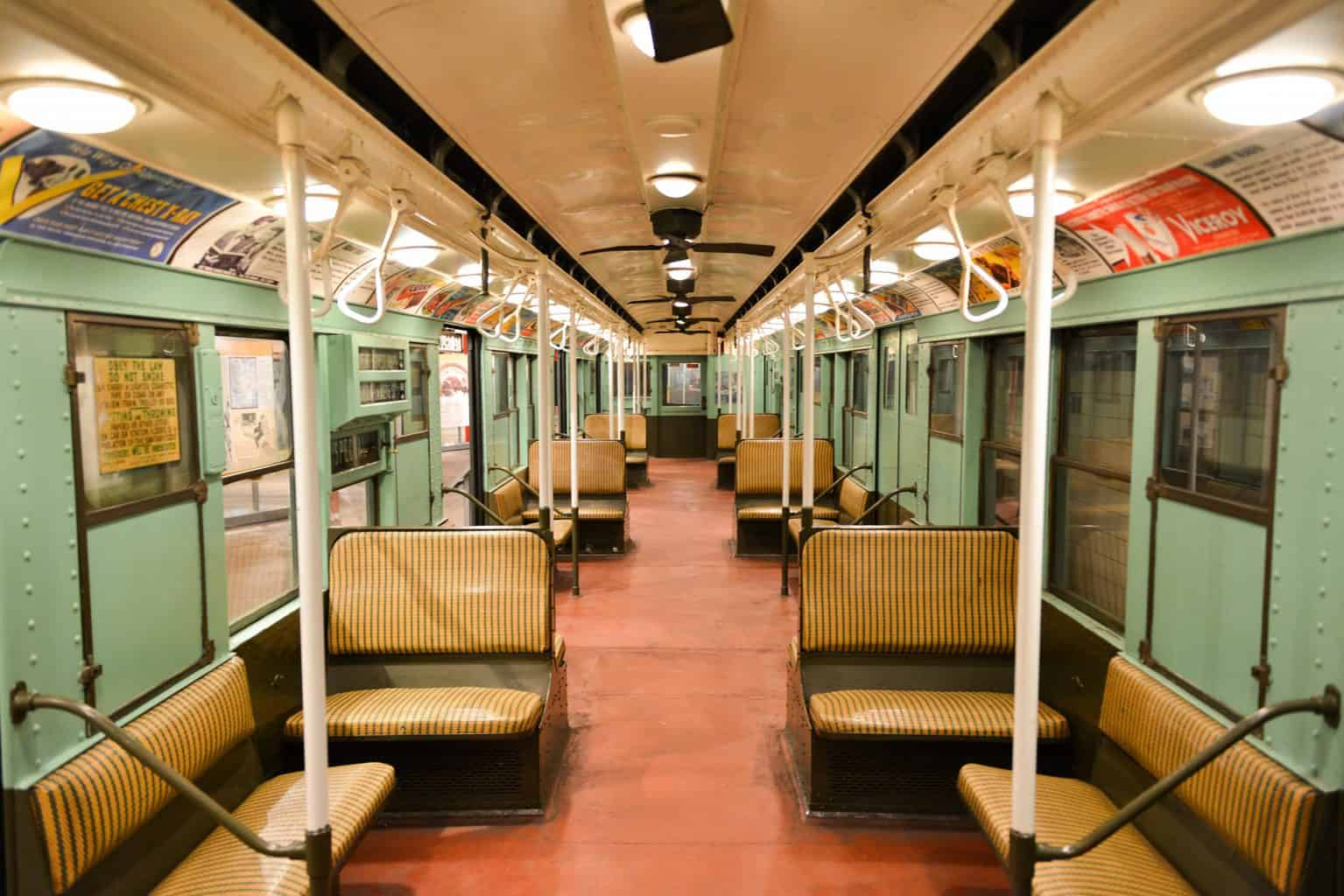 The interior of a vintage subway car in the Transit Museum, one of the cool museums in NYC.