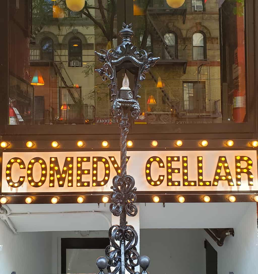 The exterior of NYC's famous comedy cellar, one of the best things to do in Lower Manhattan at night.