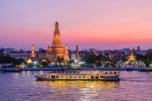 The sunset beauty of Bangkok's Chao Phraya River and Wat Arun.