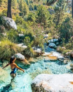 The beautiful, turquoise water of the Rio Verde in the Sierras de Tejeda of Spain.