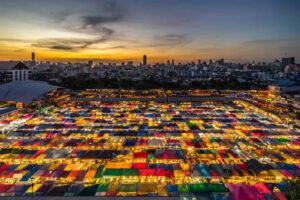 The colorful glow of Rot Fai Night Market in Srinakarin, Bangkok.