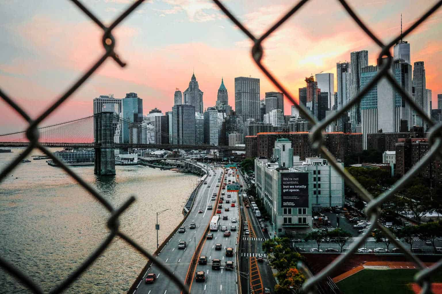 view of New York city through a fence