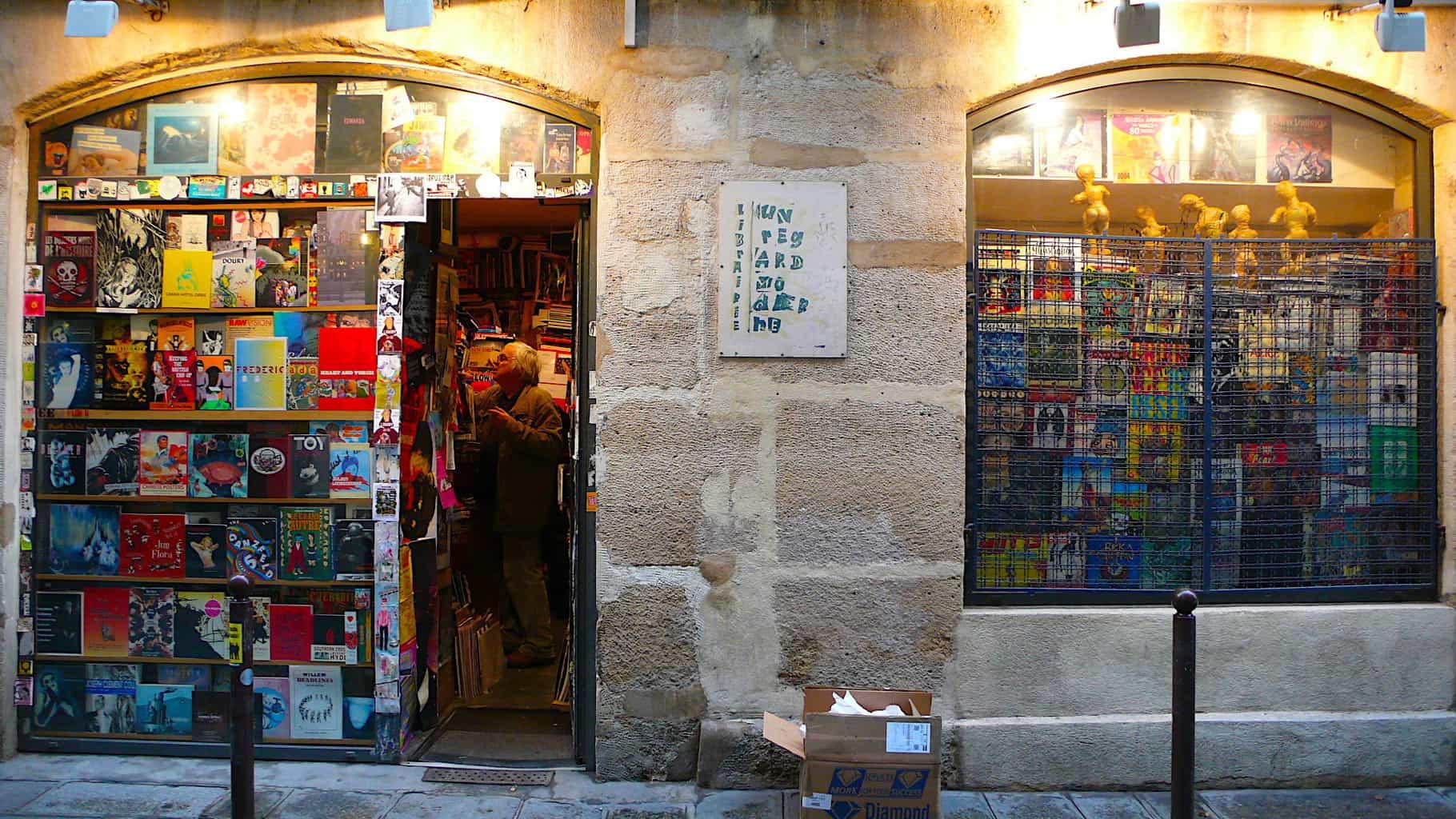 The unassuming stone facade of Un Regard Moderne bookshop in Paris