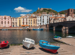 The quaint, coastal charm of Bosa, Italy in Sardinia.