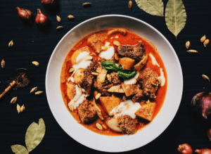 Stop for dinner at Rabbit Coffee x PadThai Kathu and try their Massaman Curry!