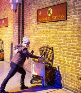 While in London, stop by King's Cross Station and visit Platform 9 and 3/4 location there.