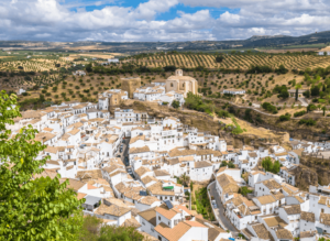 Spain's shimmering white city of Setenil de las Bodegas, the perfect place to visit as you solo travel Spain.