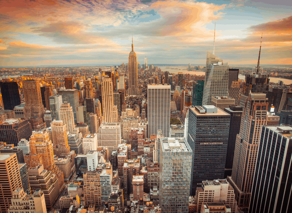 An aerial view of New York City and the Empire State Building in the background.