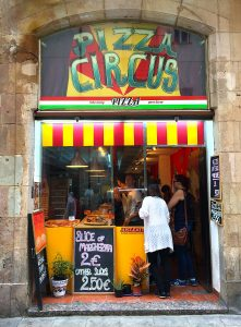 The unassuming exterior of Pizza Circus in Barcelona, Spain.
