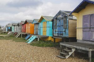 Some of the colorful bathhouses that you'll find in the seaside town of Whitstable, England.