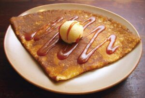 Stop and try a delicious crepe at Breizh Cafe and don't forget to pick up some crepe mix before you go since it makes one of the best souvenirs from Paris! (Photo taken and sourced from the Breizh Cafe website).