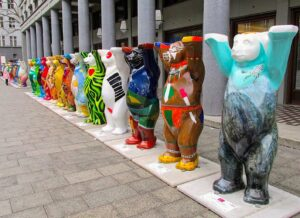 Some vibrantly decorated, Berlin Buddy Bears in their natural habitat.