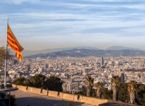 The La Senyera flag flying high over Barcelona, Spain.