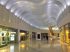 The beautiful, modern architecture of the Icon Outlet at O2, one of the best, cheap London shopping spots out there.