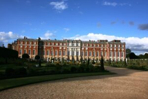 The beautiful, red-brick, Baroque-style exterior of London's iconic, Hampton Court Palace.