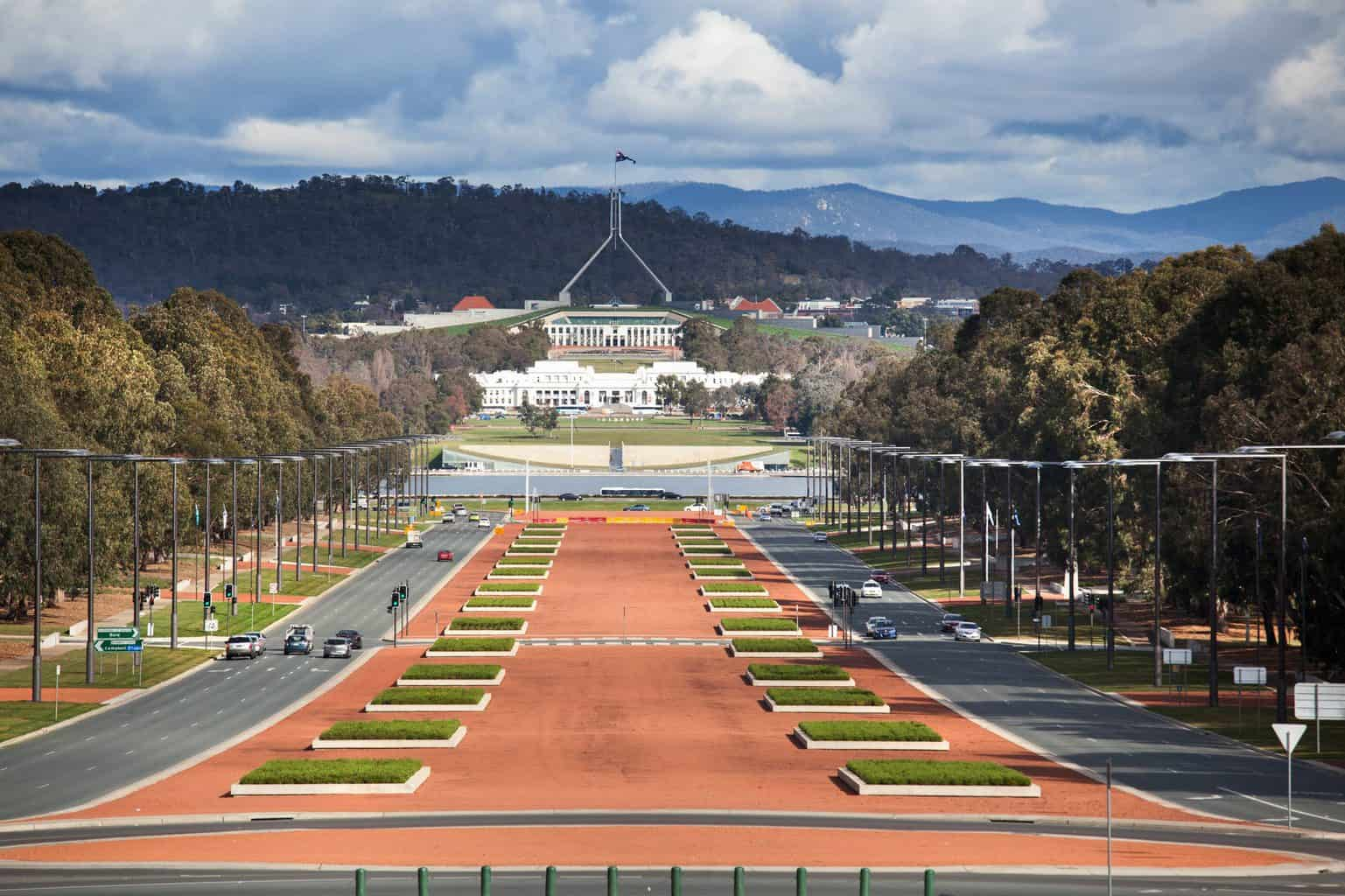 A sweeping, landscape view of Parliament House from the war museum in Canberra.