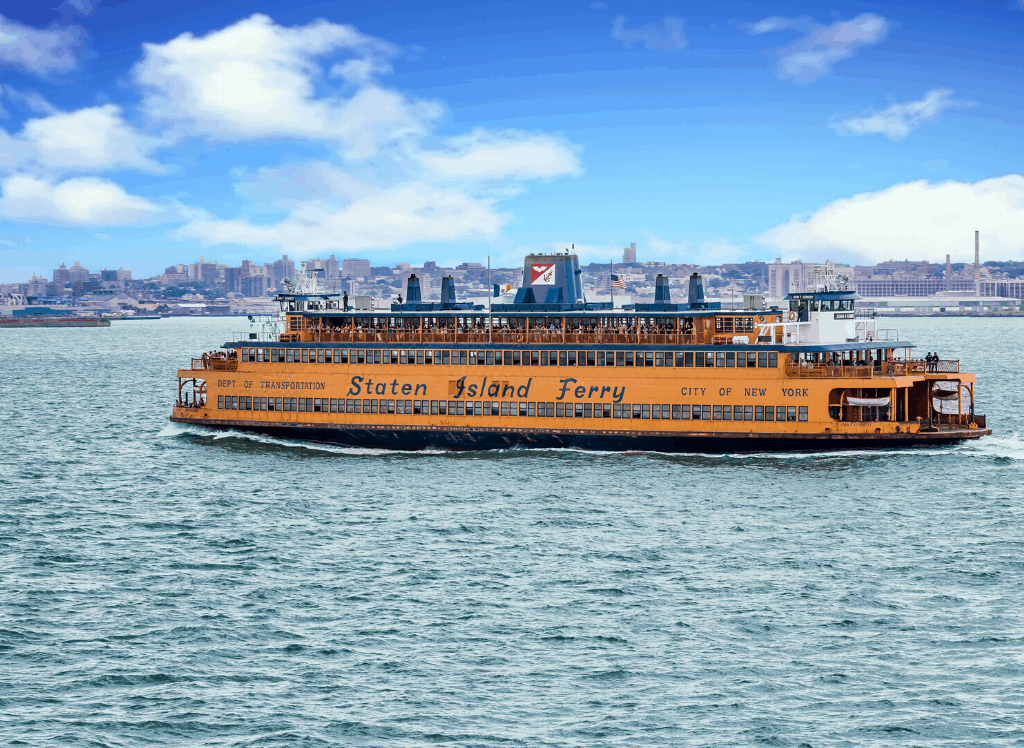 The iconic Staten Island Ferry gliding across New York Harbor. It's easily one of the best free things to do in NYC