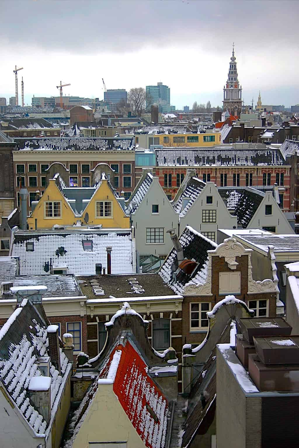 The quaint canal houses of Amsterdam covered in snow.