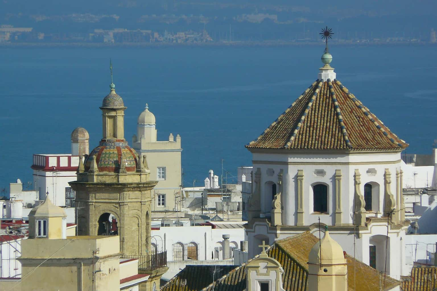 Some of the medieval buildings that dot the skyline of the seaside city of Cadiz, Spain.