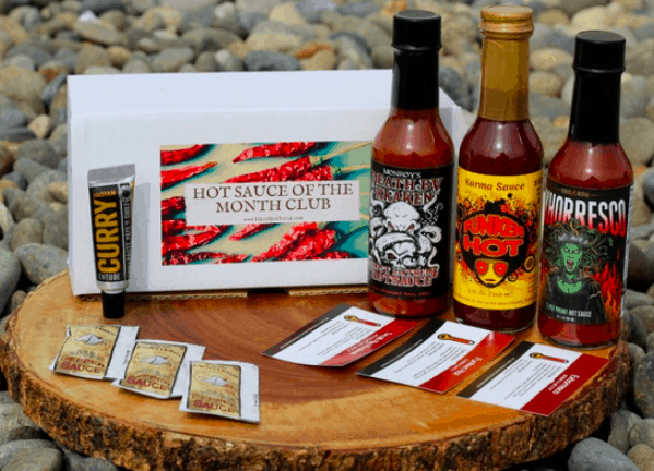 Just some of the amazing hot sauces you'll receive as a member of the hot sauce of the month club.