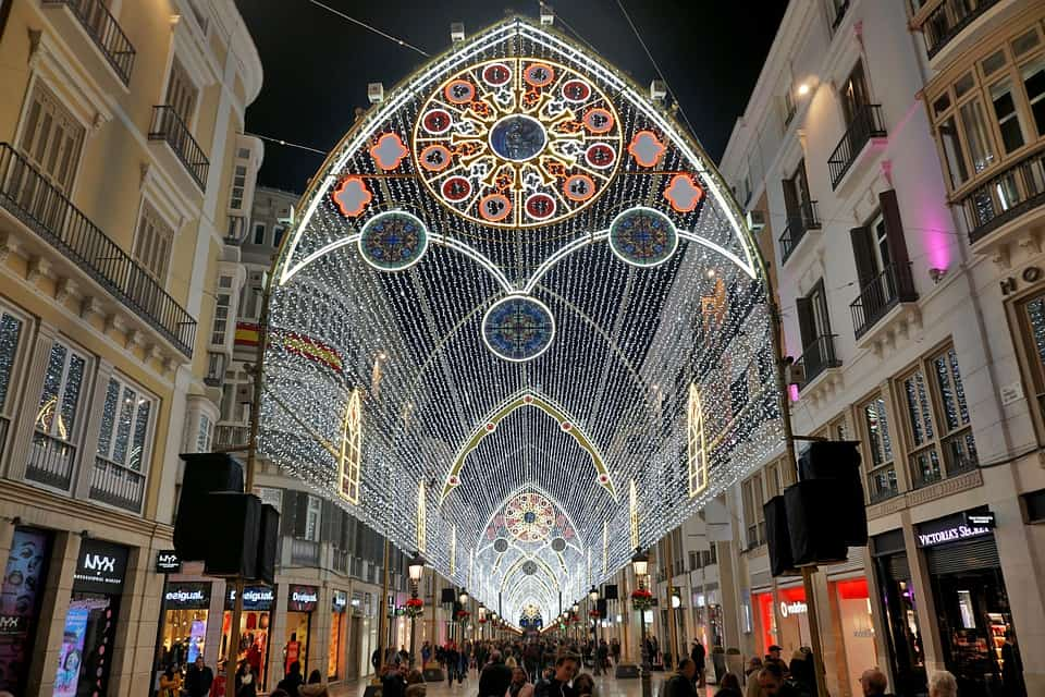 Some of the amazing holiday light displays you'll find in Malaga, Spain, one of the best places to spend Christmas in Europe.
