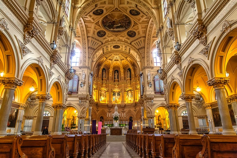 The grand interior of the Flatiron district's Church of St. Francis Xavier, in New York City.
