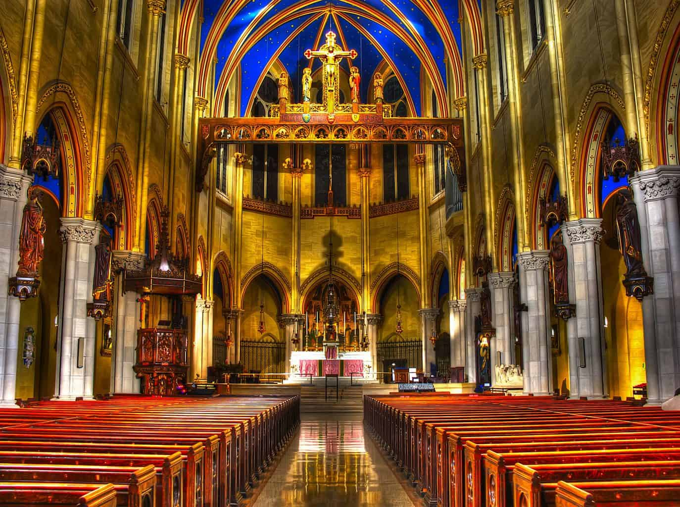The expansive, blue, and gold interior of St. Mary the Virgin Church near Times Square, New York City (image sourced from Flickr.com).