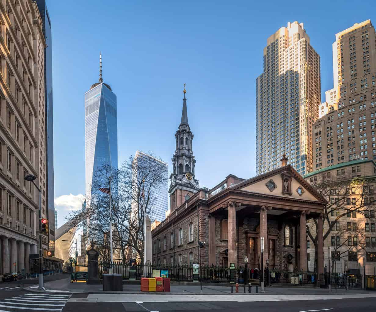 St. Paul's Cathedral quietly sits in Lower Manhattan with One World Trade Center standing tall in the background.