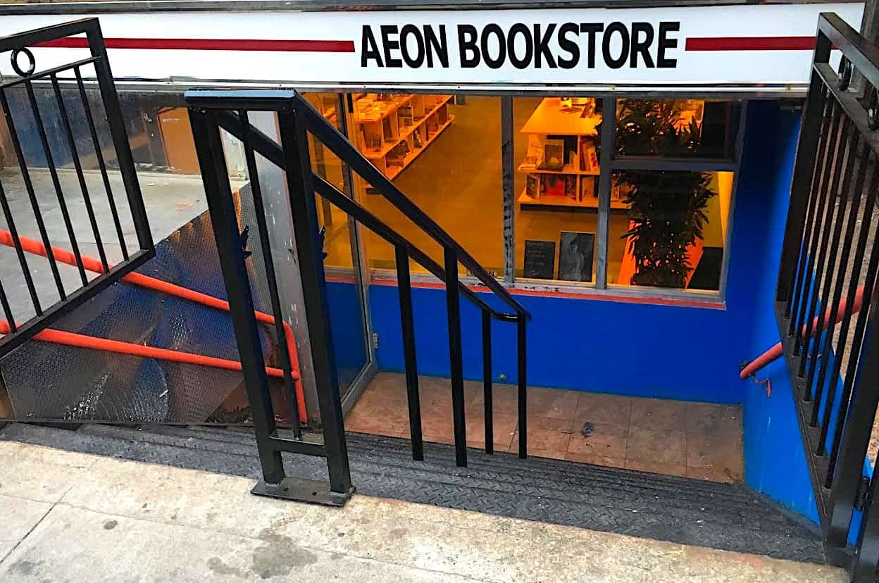 The basement level exterior of Aeon Bookstore in Manhattan, one of the best bookstores in NYC.