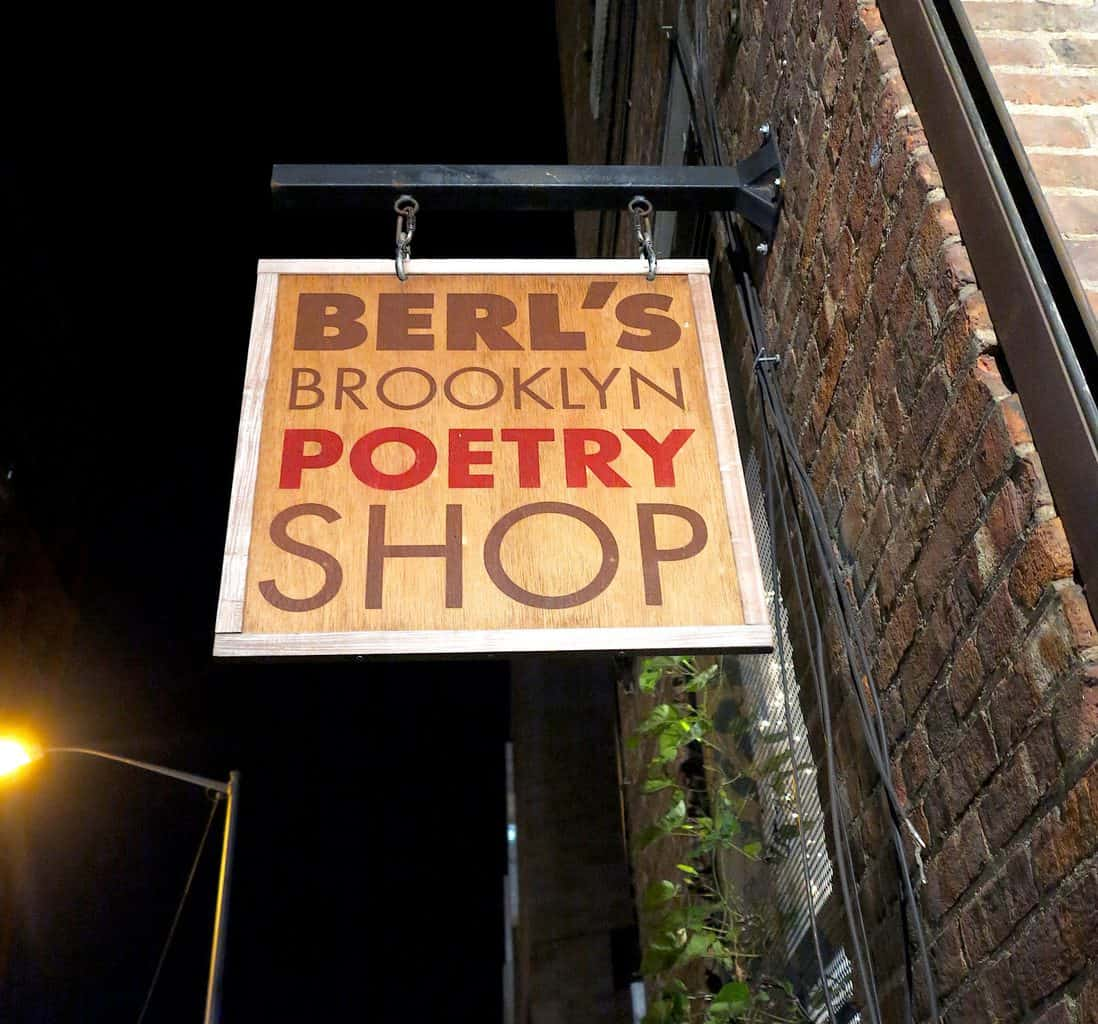 The sign outside of Berl's Brooklyn Poetry Shop. The image was taken by Clay Hensley of Flickr.com.