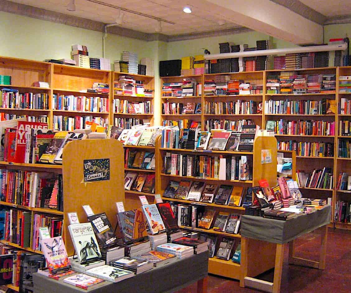 The spacious, book-filled interior of Bluestocking Bookstore, Cafe, and Activist Center.