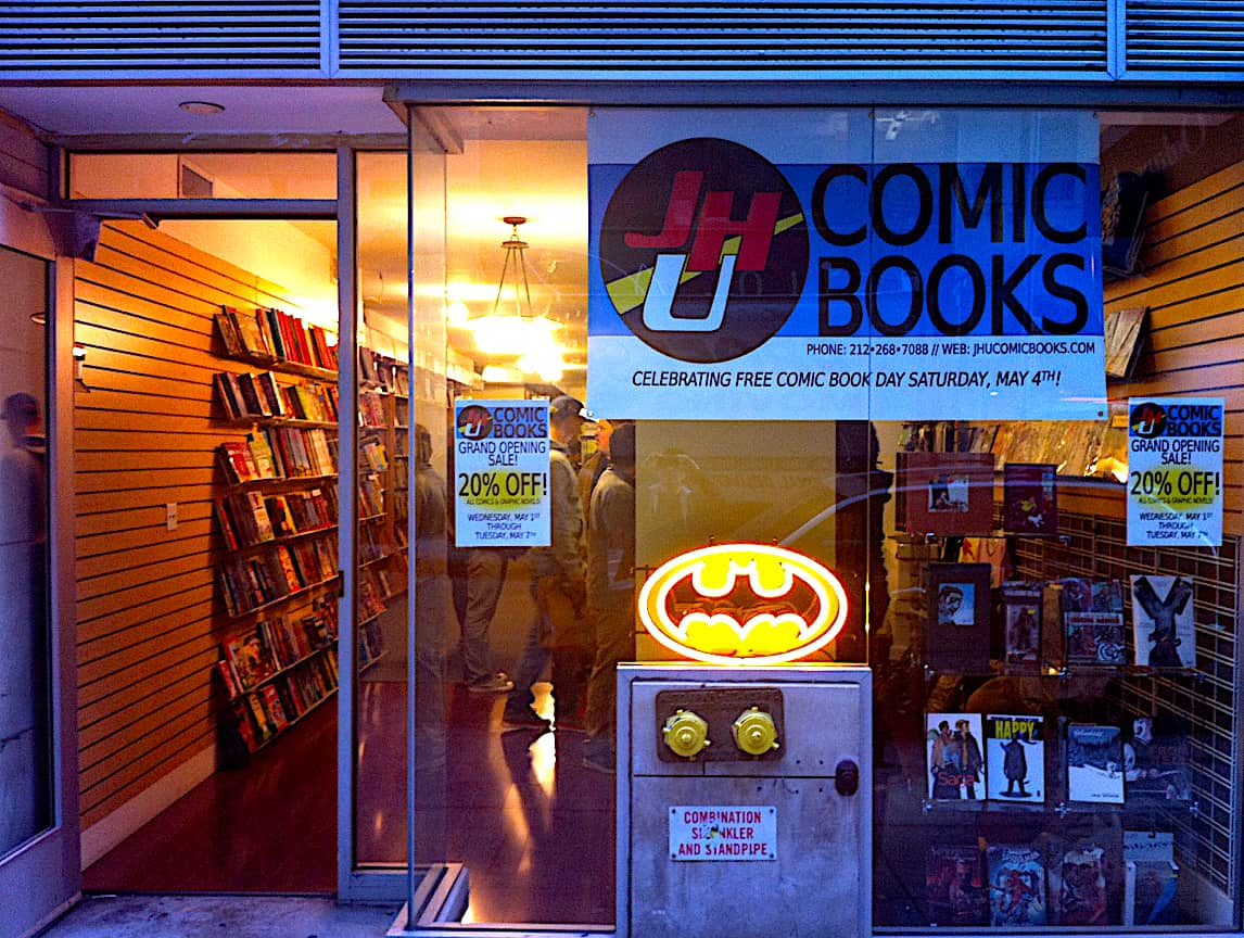 The low-key, blue-hued exterior of JHU Comic Books in Staten Island, New York.