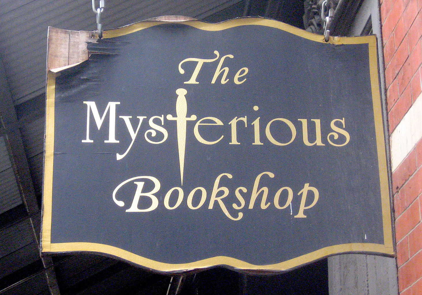 The slightly ominous sign in front of the Mysterious Bookshop in Manhattan, New York.