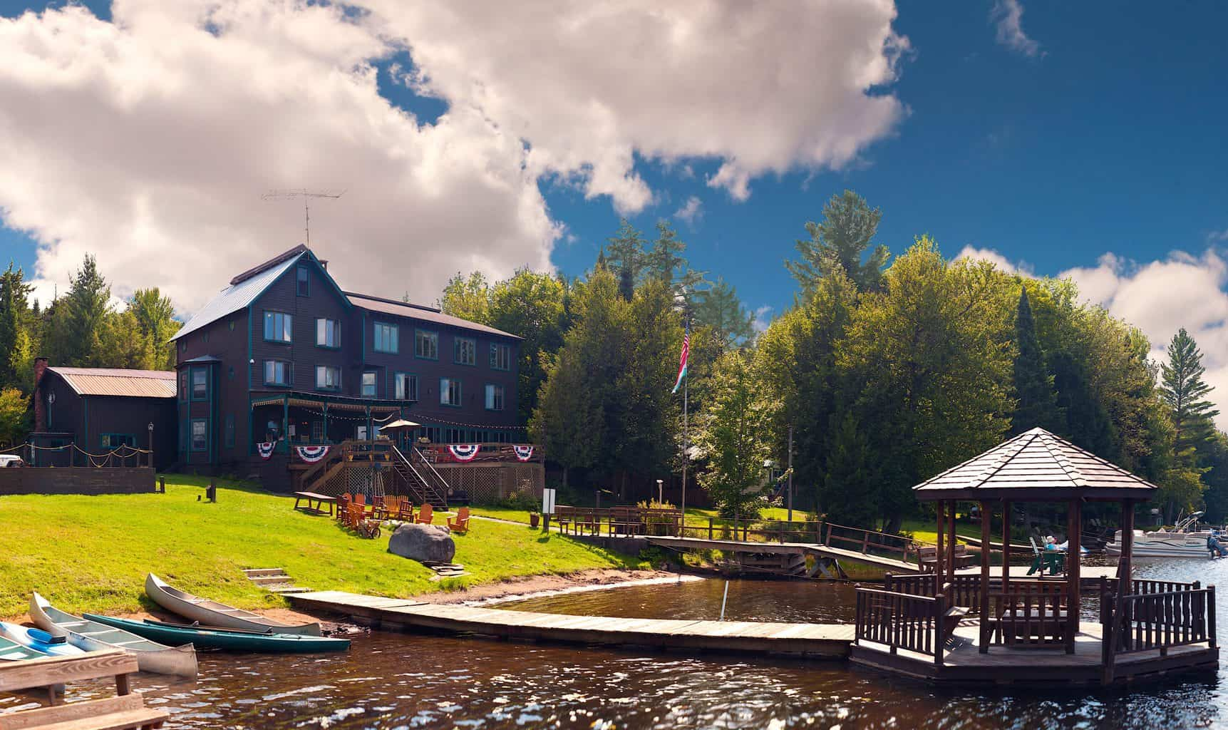 A view of Big Moose Inn nestled along the shores of Big Moose Lake.