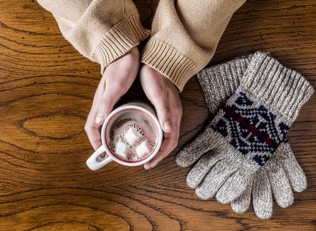 Holding a cup of hot cocoa during the winter.