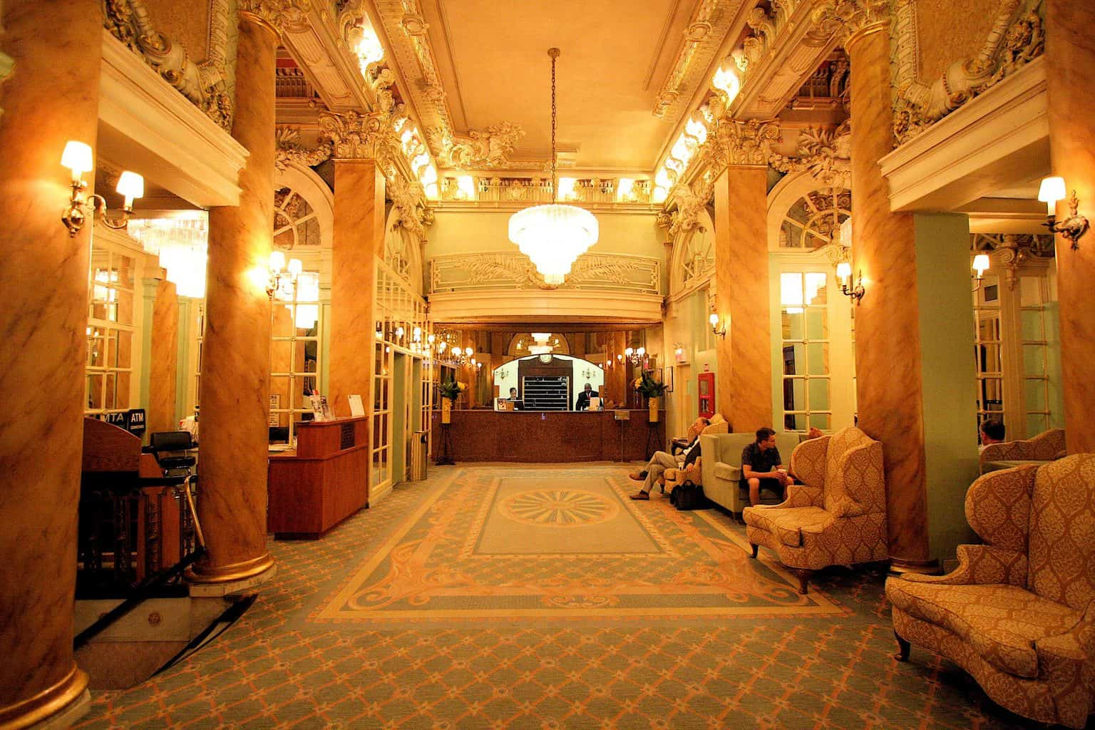 The luxurious, grand entranceway of the Wolcott Hotel in New York City!