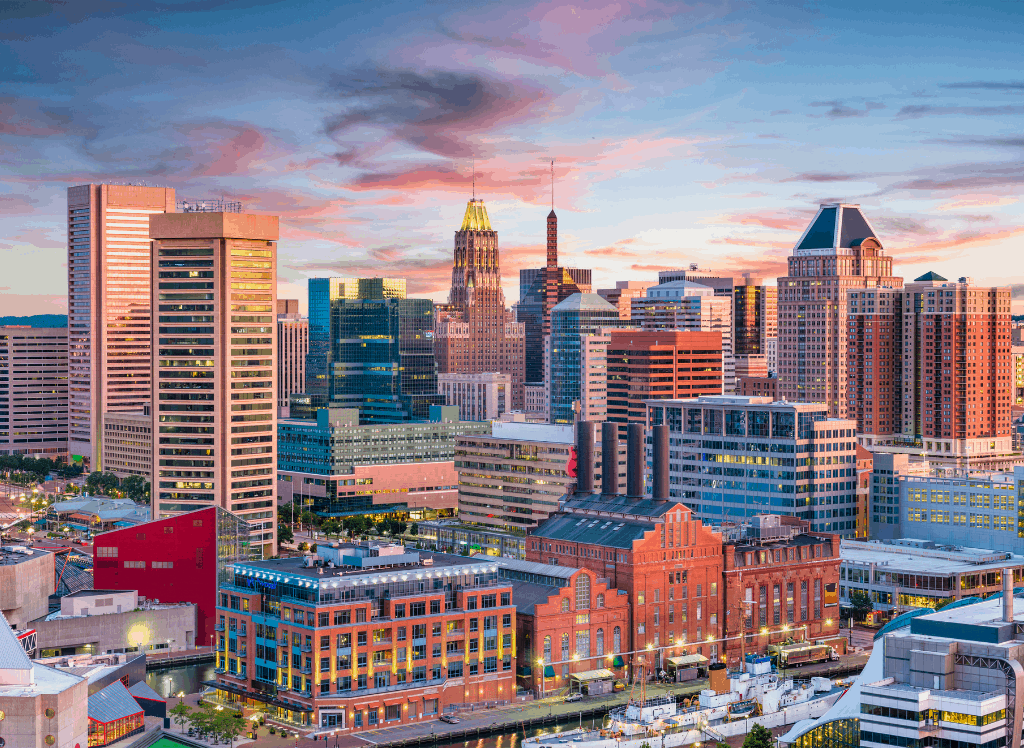A skyline view of Baltimore's famous inner harbor at sunset.