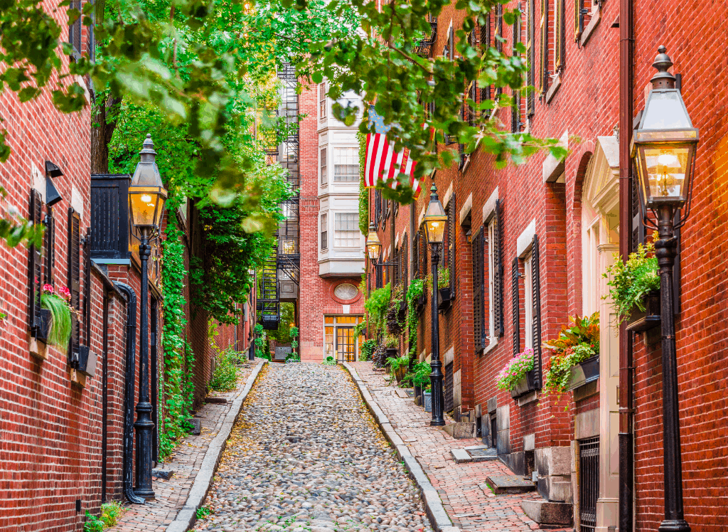 The historic, brick buildings you'll find along the quaint AF Acorn Street in Boston, Massachusetts.