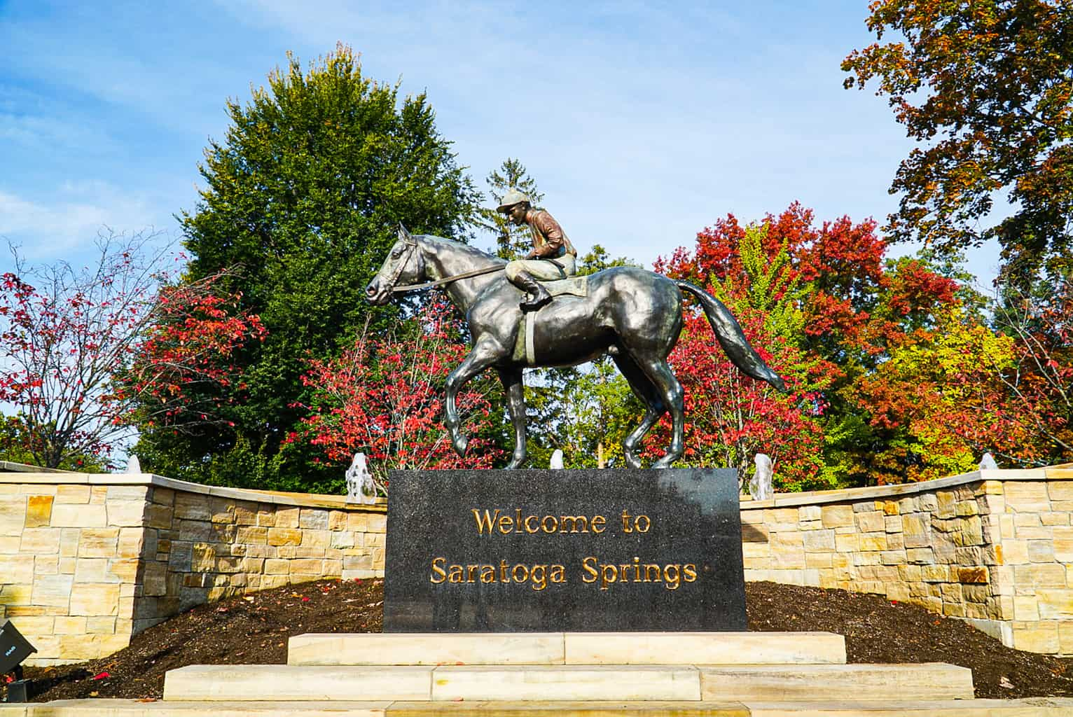 A beautiful sign in Congress Park that welcomes you to Saratoga Springs.