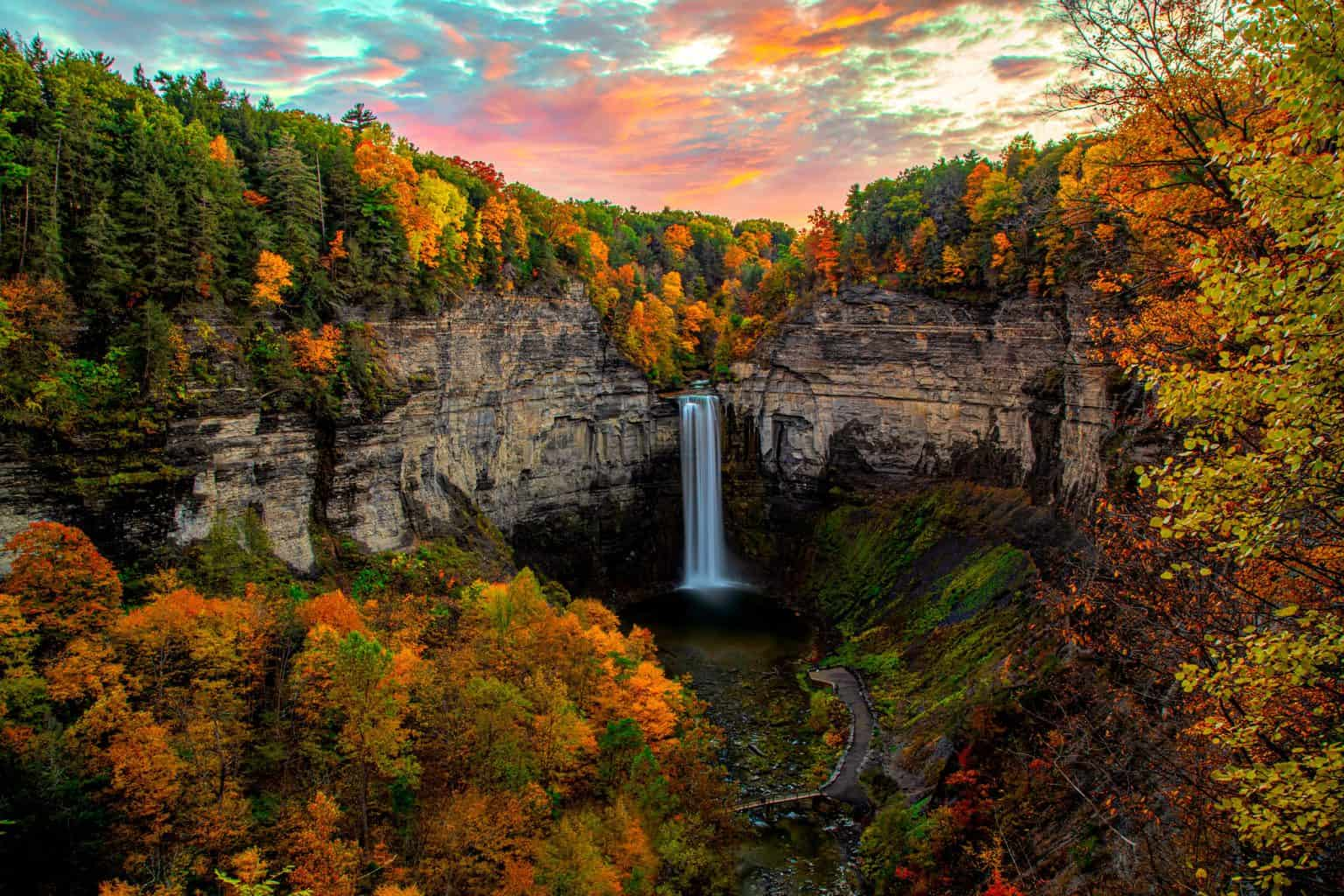 Fall foliage surrounds the beautiful, Taughannock Falls in Ulysses, NY.