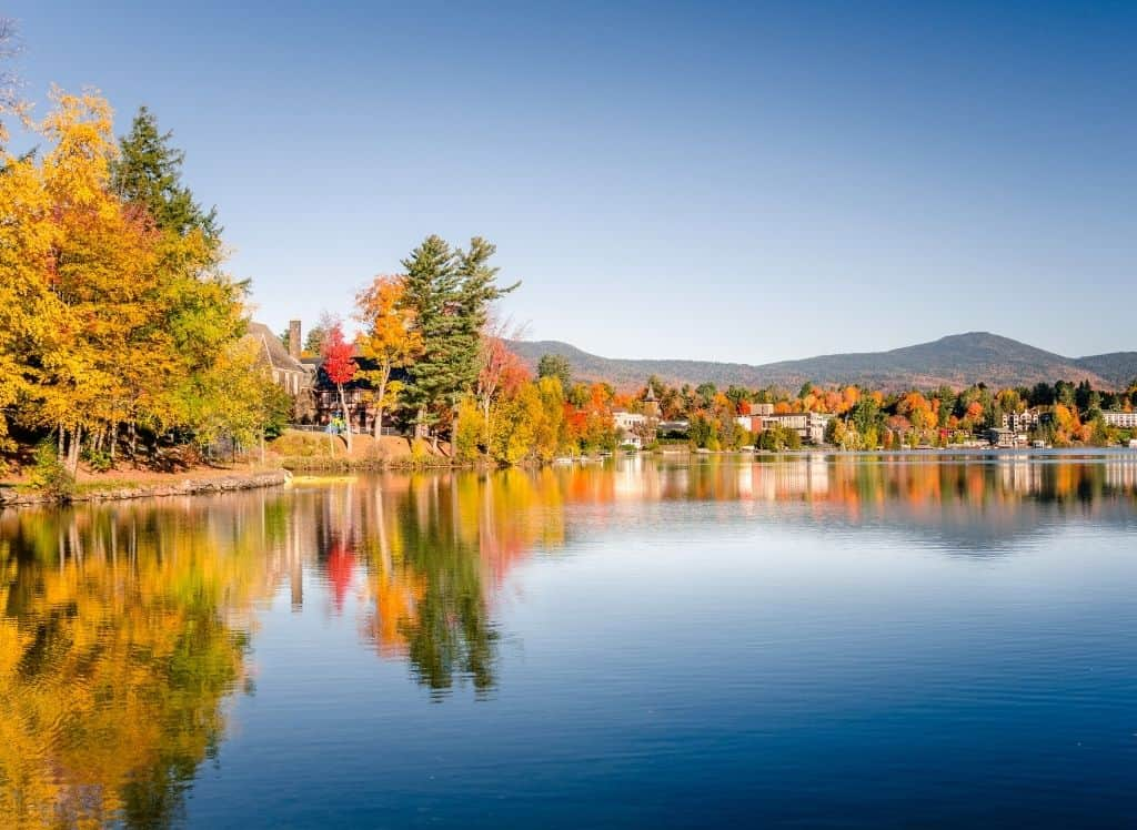 The beautiful fall foliage surrounding Mirror Lake in Lake Placid.